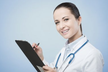 Confident doctor with medical records