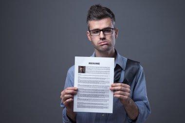 Sad businessman looking for a job