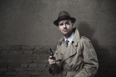 Vintage detective with revolver