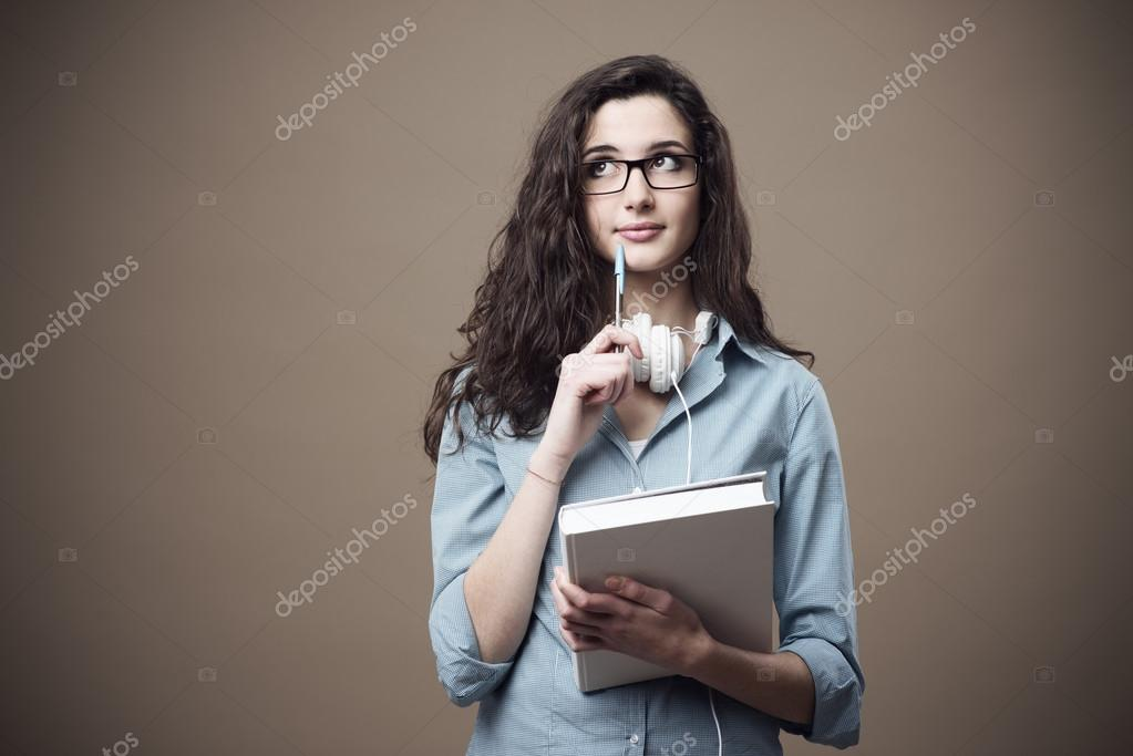 Cute student girl taking notes