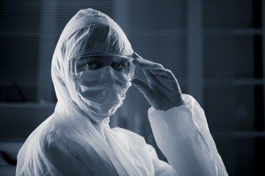 Researcher in hazmat suit