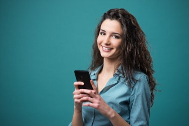 Smiling young woman with mobile