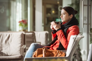 Woman relaxing at the cafe