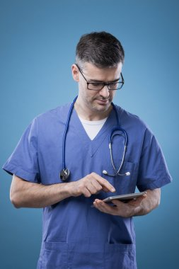 Doctor using a touch screen tablet