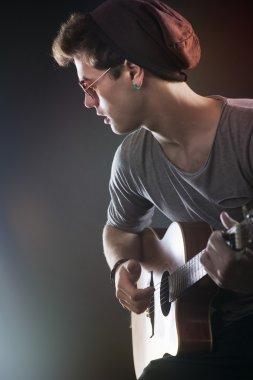 Teenager rock star performing