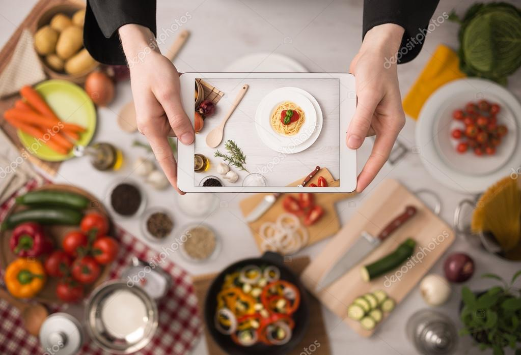 Cooking app stock photo stockasso 70858923 cooks hands holding a touch screen tablet close up kitchen table with food ingredients vegetables and utensils on background top view photo by forumfinder Choice Image