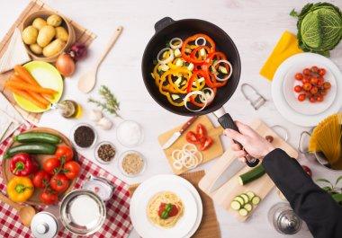 Cook frying sliced vegetables