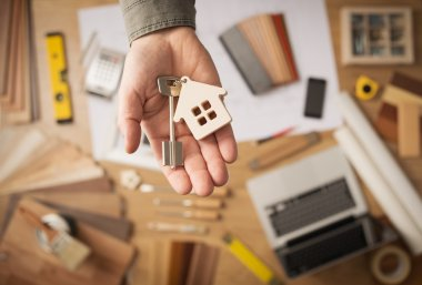 Real estate agent with house key