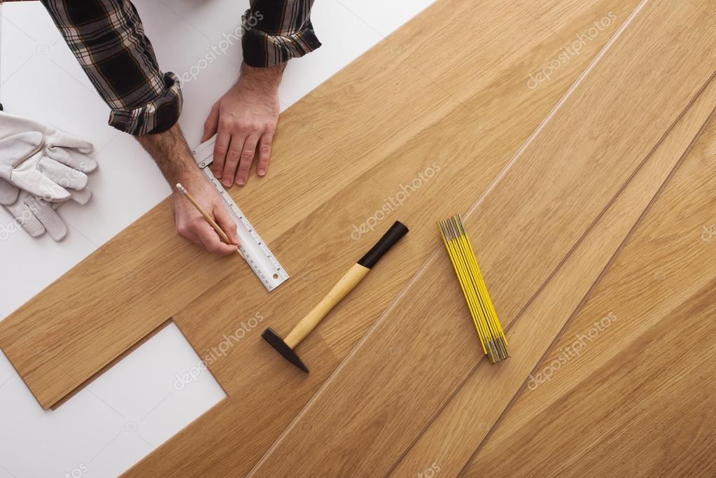 Carpenter installing a wooden flooring