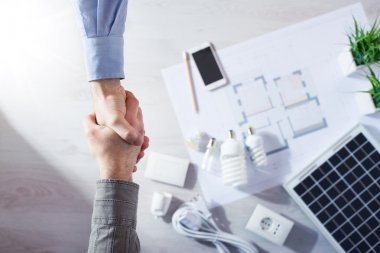 Contractor and customer shaking hands