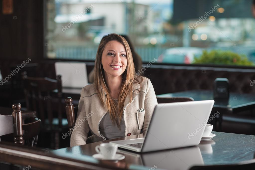 Beautiful woman at the cafe with a laptop