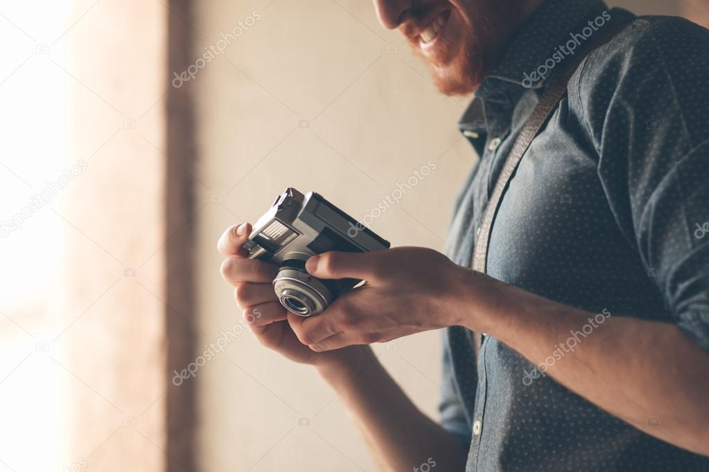 Hipster young man with vintage camera