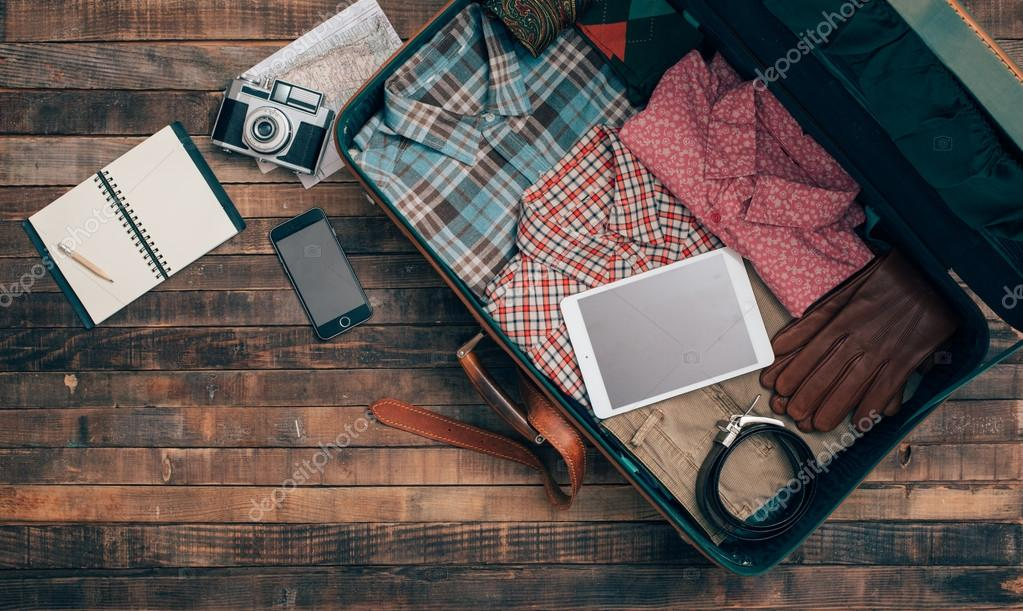 Hipster traveler packing