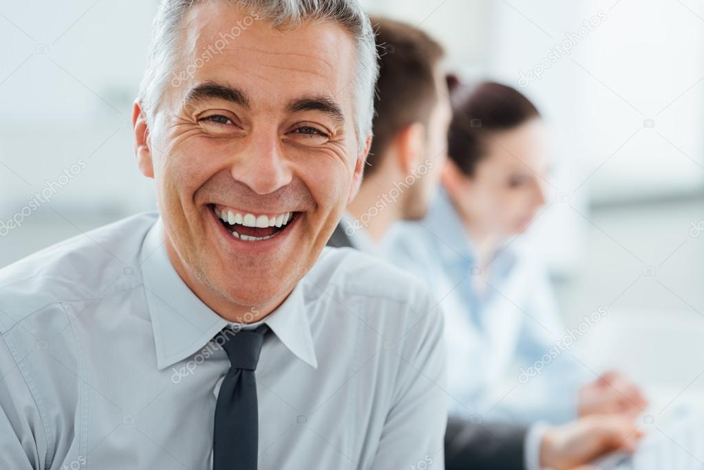 Confident smiling businessman posing