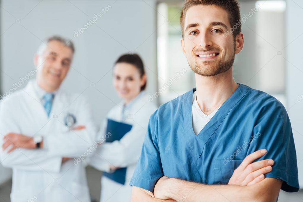 Young doctor posing and smiling at camera
