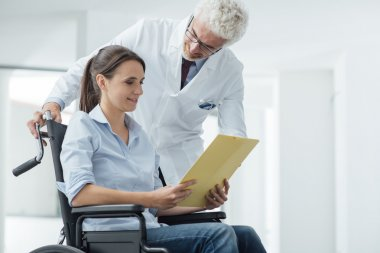 Doctor and patient examining medical records