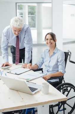 Confident businesswoman in wheelchair