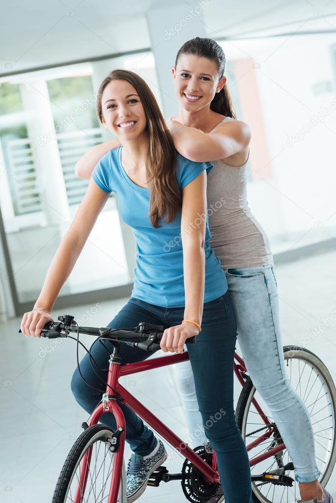 Beautiful girls with a red bicycle