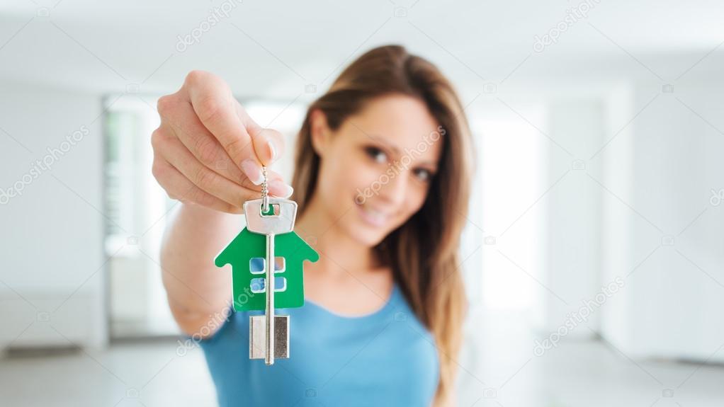 Beautiful woman holding house keys