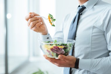 Businessman having a vegetables salad for lunch, healthy eating and lifestyle concept, unrecognizable person stock vector
