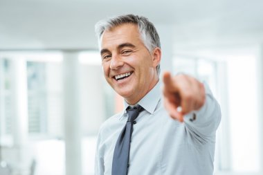 Businessman pointing at camera