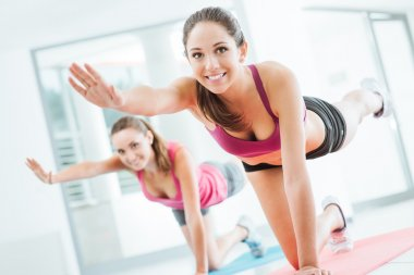 Sporty women doing pilates workout
