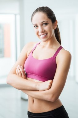 Young woman posing at the gym