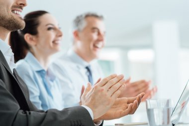 Business people clapping hands during a seminar