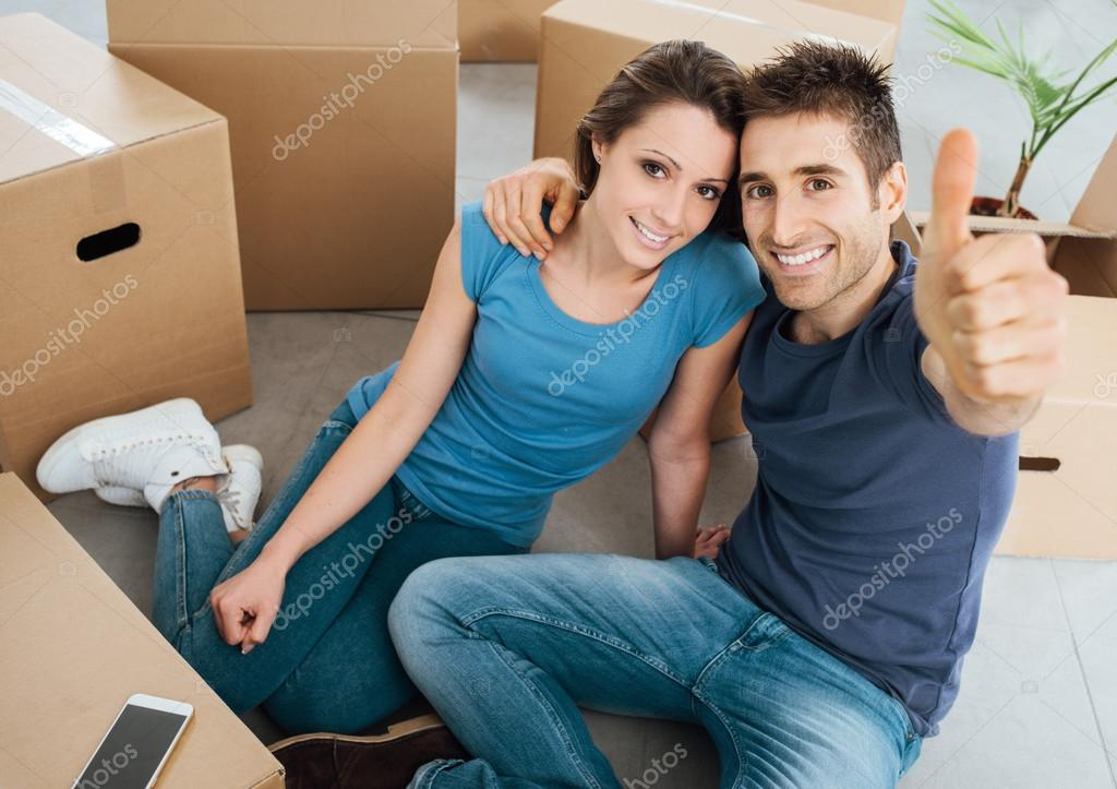 Happy couple moving in their new house