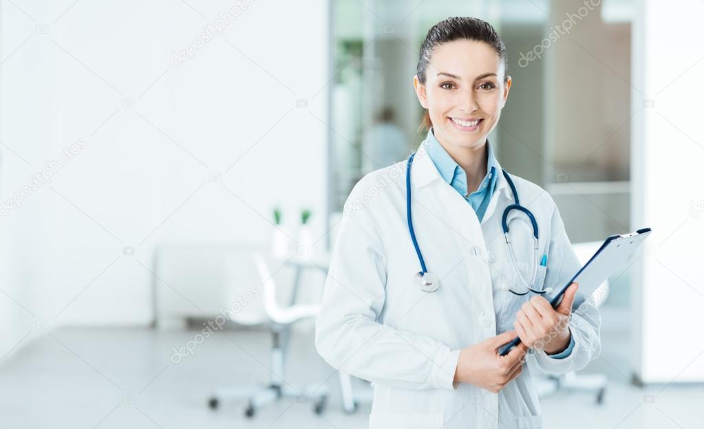 Smiling female doctor holding medical records