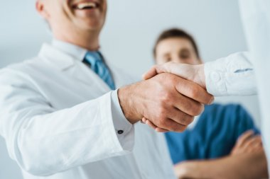 Doctors handshaking at hospital