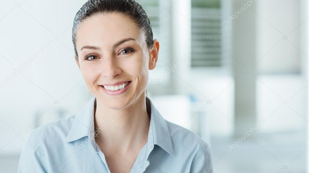Beautiful smiling business woman posing in the office