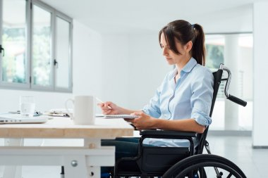 Confident disabled businesswoman at work