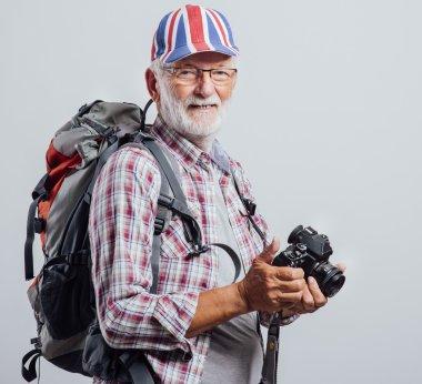 Senior explorer with digital camera