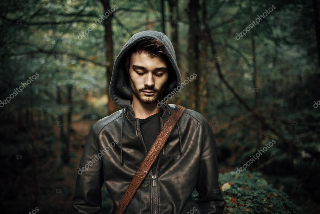 Young man posing in the woods