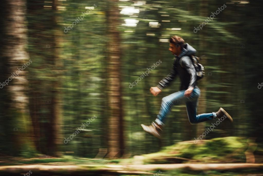 Man running in the forest