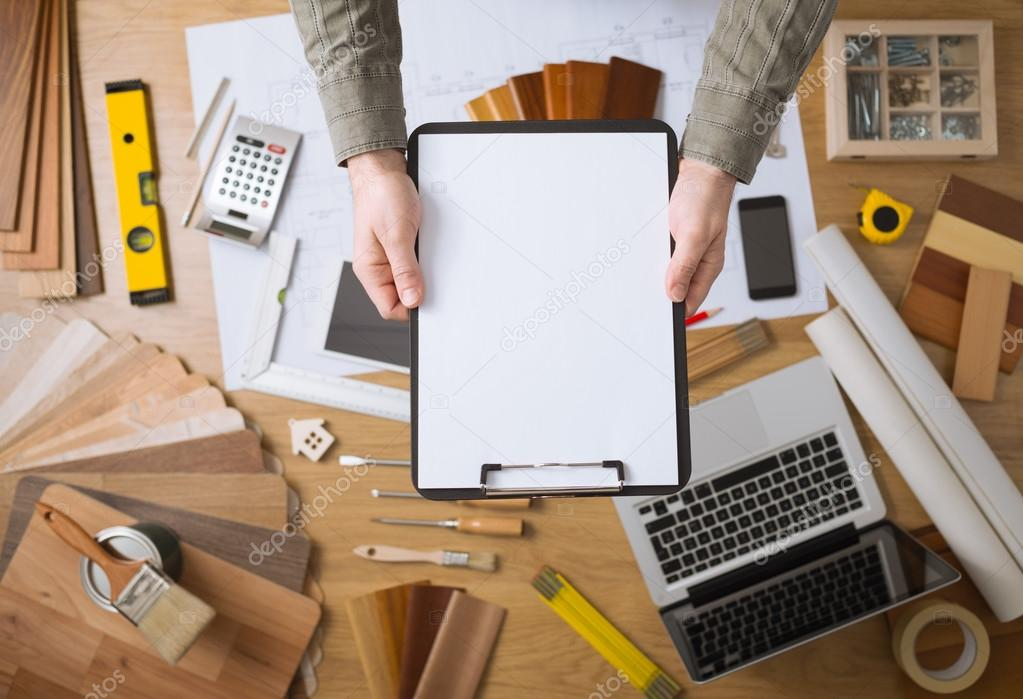 Home renovation concept with blank clipboard