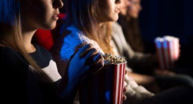 Friends at the cinema watching a movie