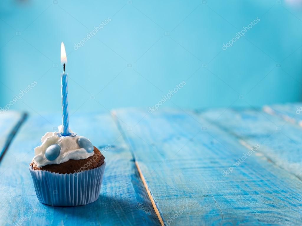 birthday cupcake over blue background Stock Photo peterzsuzsa