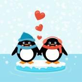 Fotografia Due pinguini sulla banchisa con cuori