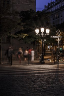 Blurred people on zebra crossing at night