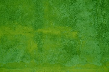 Grunge Background of green and yellow stone wall