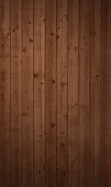 Vertical background of an old brown wooden wall