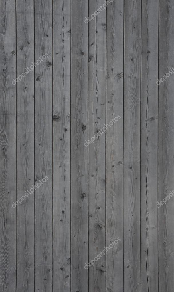 Vertical background of an old gray wooden wall