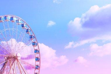 Ferris wheel on the background of a bright clear sky . Helsinki.