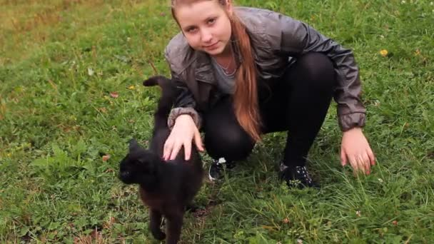 Girl Plays With Nice Black Cat