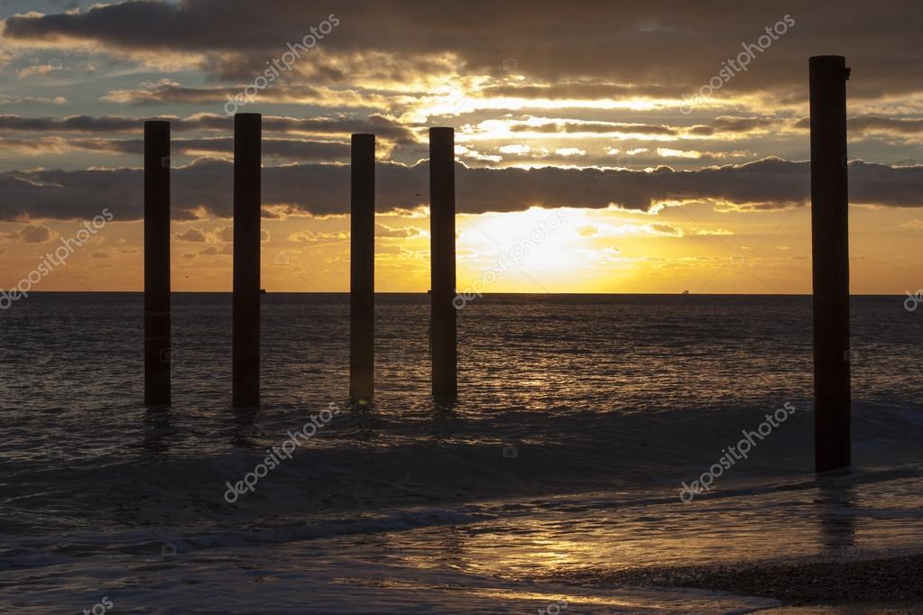 Sundown by old Brighton Pier