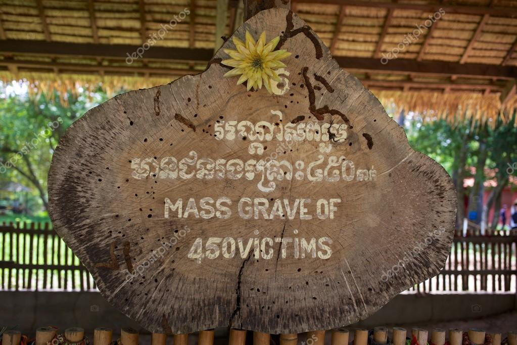 Sign marking location of mass grave in Killing Fields, Cambodia