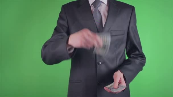 Handsome young man throwing money on chroma key
