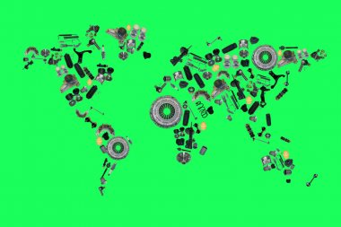 world map from lot of car spare parts isolated on green background